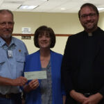 Knights of Columbus Grand Knight, Randy Proske presenting to Sacred Heart School a check for $10,000 dollars. Accepting the check are LaDonna Voelkel (principal of Sacred Heart School) and Father Matthew Kinney