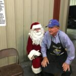Hank Holub telling Santa Clause his want list