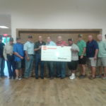 Nick Deters with What A Burger presented to Arlin Kielers a check for the restoration of the KC Center