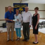 Grand Knight, Randy Proske, presenting a check for 10,000 dollars to Sacred Heart School. Accepting the check is Pam Keilers, along with board members Jim Trlicek and Phyllis Proske