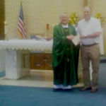 Father Dan Kahlich receives $2,500 check for 50 years of priesthood