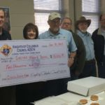 KC presenting check to Sacred Heart School